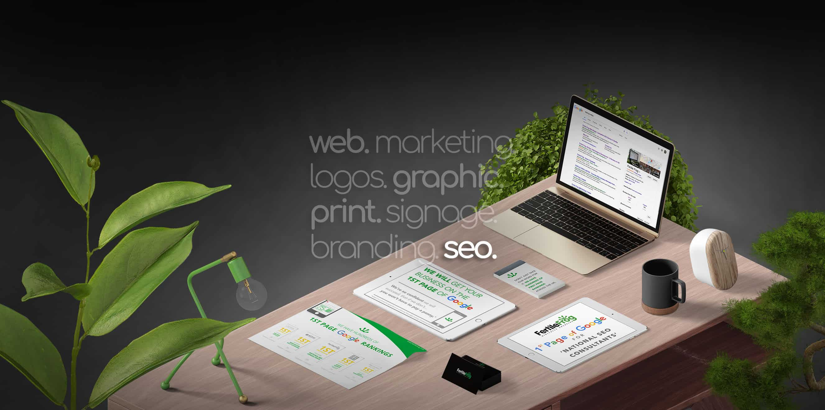 Fertile Frog SEO work on table with mac book, phone, ipad, paper showing work