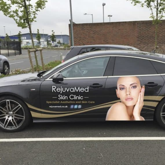 black car with signage on advertising RejuvaMed Skin Clinic