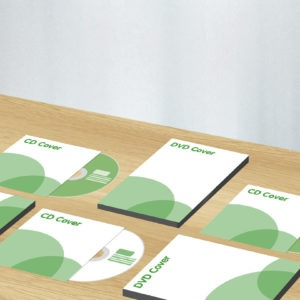 Green and white graphic image of CD and DVD covers