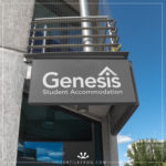 Genesis Student Accommodation logo on a outdoor sign