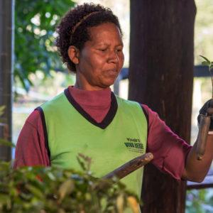 Portrait of woman holding seedlings